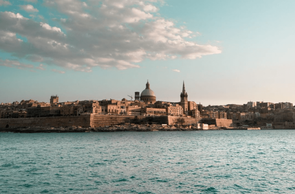 The island of Malta on a sunny day, as seen from the sea.