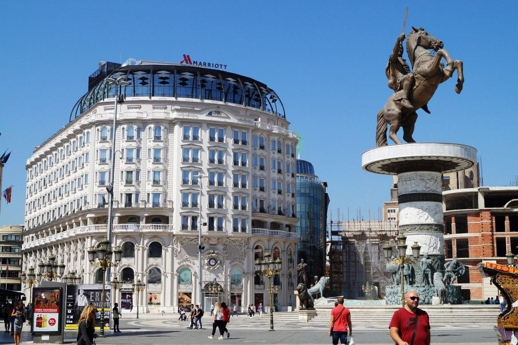 The Marriott hotel in Skopje with a statue of Alexander the Great in front.