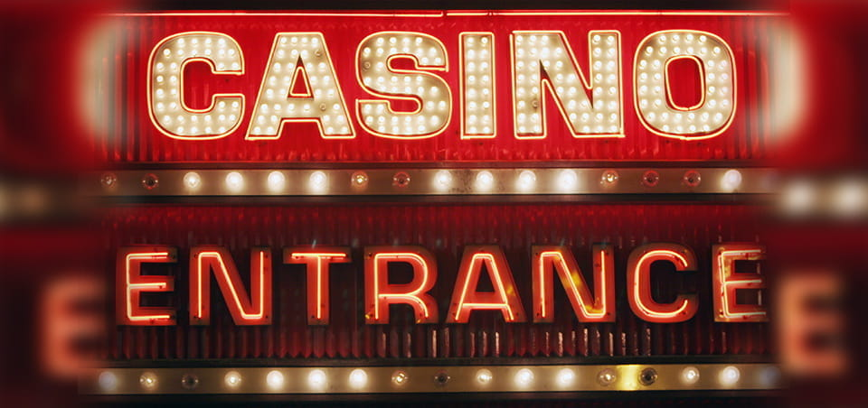 "A lit and neon sign saying ""Casino Entrance""."
