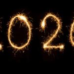 2020 written with sparklers against a dark background.