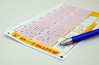 A 6aus49 lotto card with a pen on top.