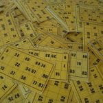A massive pile of yellow bingo cards.