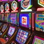 A row of glowing slot machines.