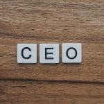 The letters CEO spelt out on tiles.