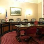 A committee meeting room with empty chairs.
