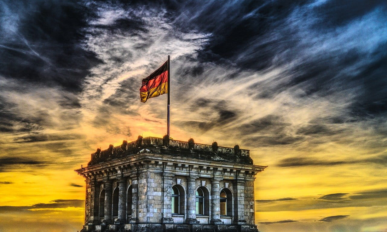 The German flag flying from a building.