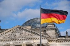 The German flag flying in front of the Reichstag in Berlin.