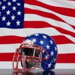 NFL Helmet with stars in front of waving USA flag.