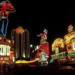 he Las Vegas Strip at night lit up with neon lights.