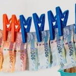 European cash being hung up to dry on a clothesline.