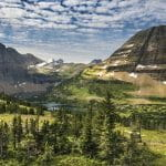 Panorama of Montana's landscape with mountains, forest and river.