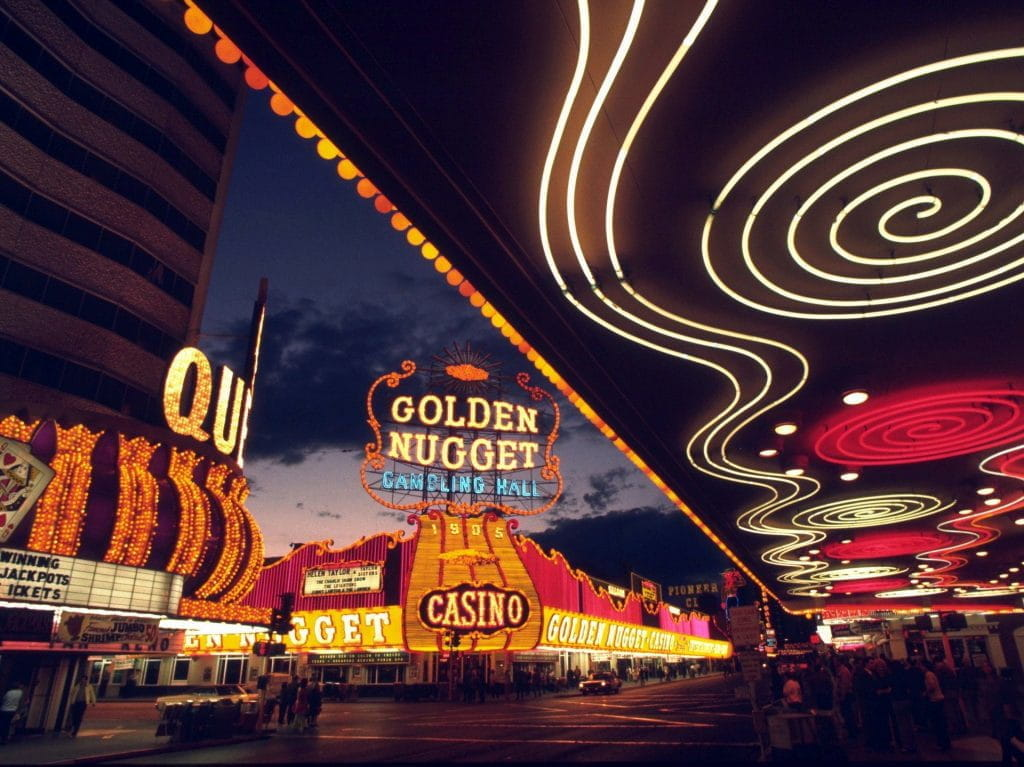 The bright, colorful lights of Las Vegas casinos, including the Golden Nugget Gambling Hall.