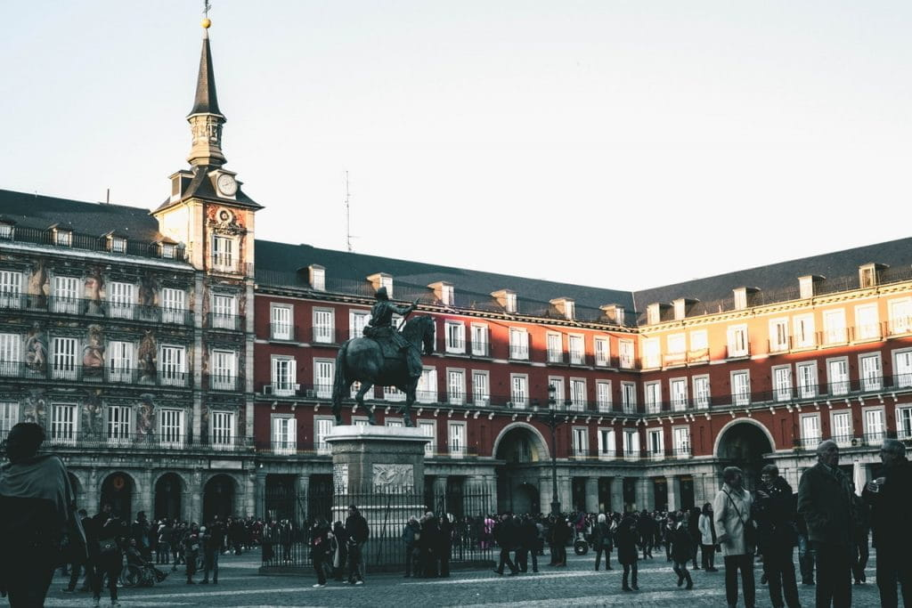 Plaza Mayor in Madrid with a bronze statue of a man on a horse.