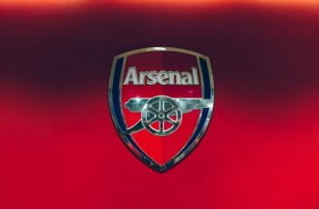 he Arsenal Gunners emblem, against a red backdrop.