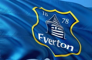 Blue flag with Everton emblem on it.