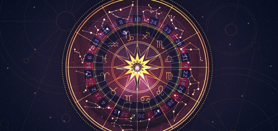 An astrological chart laid over a roulette wheel.