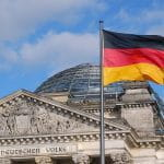 he German flag in front of the Reichstag.