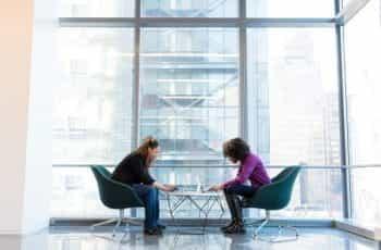 Two women working in a modern office building.