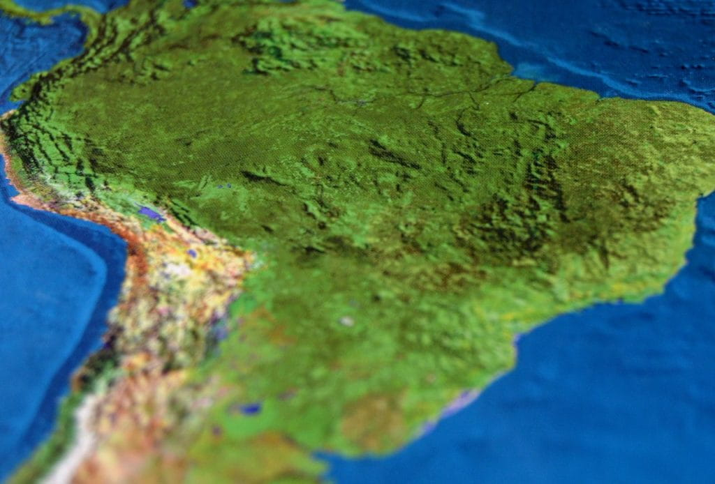 A close-up of South America on a map emphasizing the texture and realistic colors of the terrain.