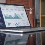 Laptop screen showing financial business statistics.