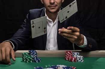A man flipping cards at the camera.