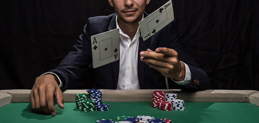 A man flipping cards at the camera.