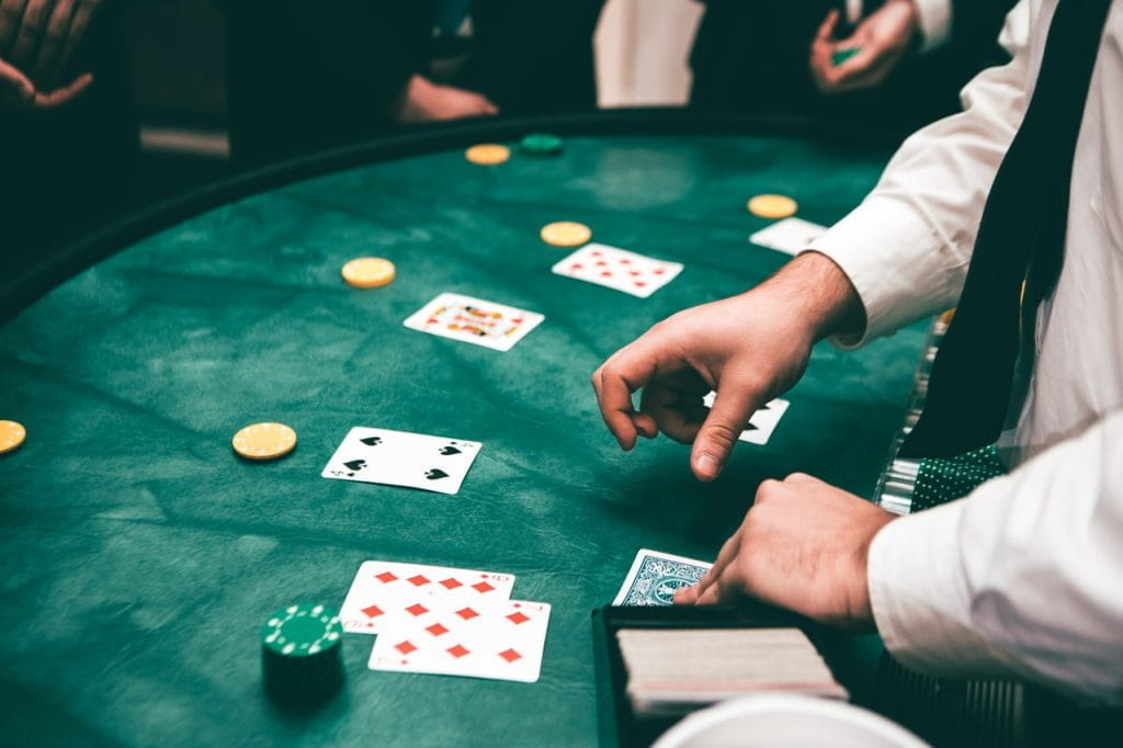 Poker dealer deals cards to players.
