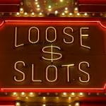 Neon 'Loose & Slots' sign from a Las Vegas casino.