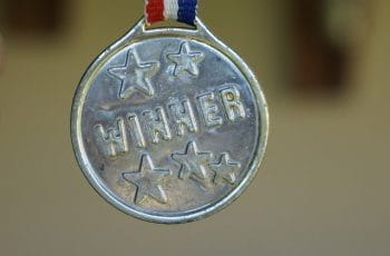 "A medal with ""winner"" written across it ."