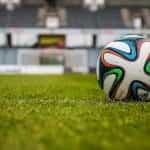 A football on a football pitch.