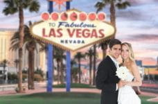 A bride and groom, with the Las Vegas Boulevard in the background.