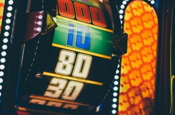 Colorful lit up slot machine reel at a casino.