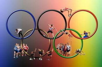 The Olympic rings and several representative athletes.