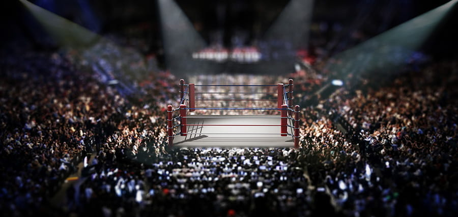 A boxing ring in a packed out venue.