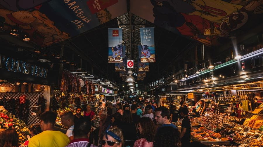 A busy indoor market in Barcelona, Spain.