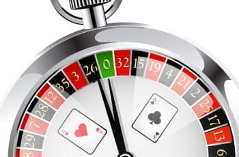 A stopwatch with a roulette wheel inside and playing cards imposed on the face.