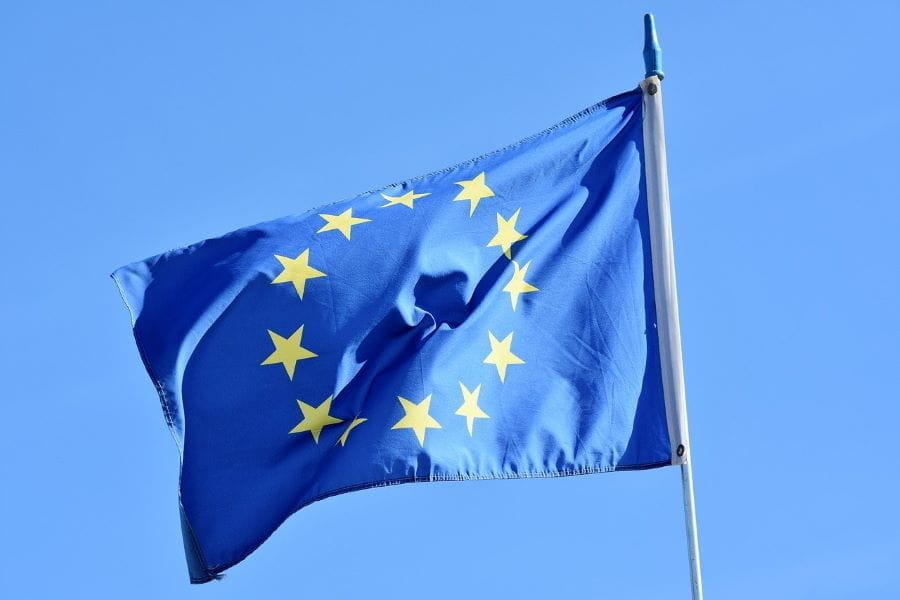 The European flag flying from a flagpole.