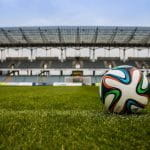 A football on a stadium pitch.