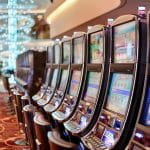 A row of slot machines in a casino.