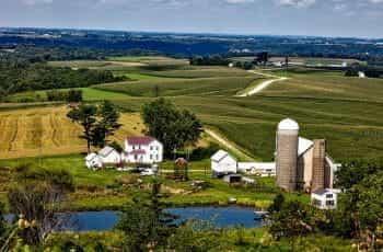 Farmland in Iowa with barn and silo.