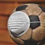 A dirty soccer ball wears an N-95 respiratory mask.