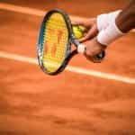 A tennis player on a clay court prepares their next shot.