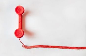 A red charity helpline telephone.