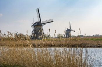 Dutch windmills on a river.
