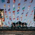 Rows of colorful paper banners are strung from the roof of a church in Valladolid, Mexico.