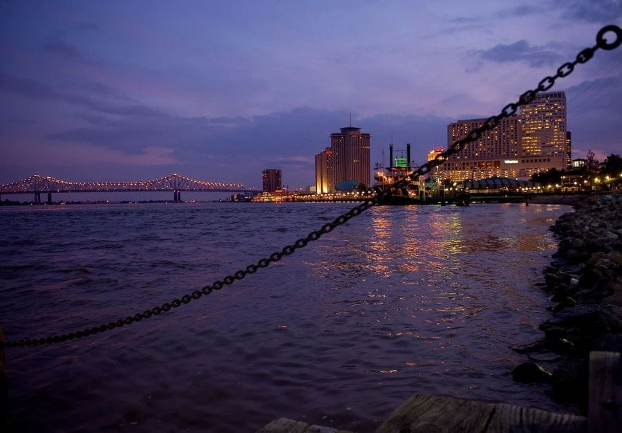 Nighttime at the boardwalk of the Mississippi River in New Orleans, Louisiana.
