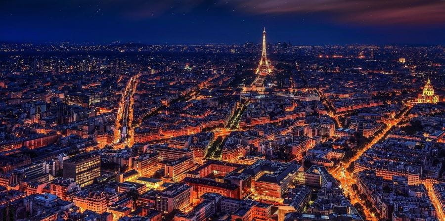 Paris at night time, the Eiffel Tower is clearly visible.