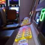 A line of slot machines in a casino.