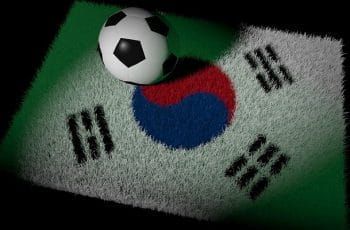 Football on South Korea carpet.