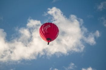 A red Virgin hot air balloon in the sky.
